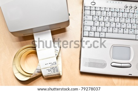 Label and barcode printer next to a notebook - stock photo