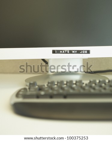 Label on a computer monitor that reads I Hate My Job - stock photo