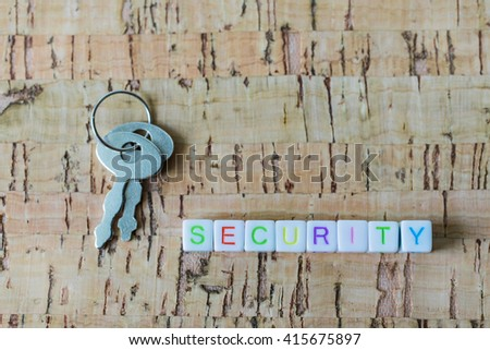 "Label word ""SECURITY"" written on plastic blocks, wood background with copyspace. - stock photo"
