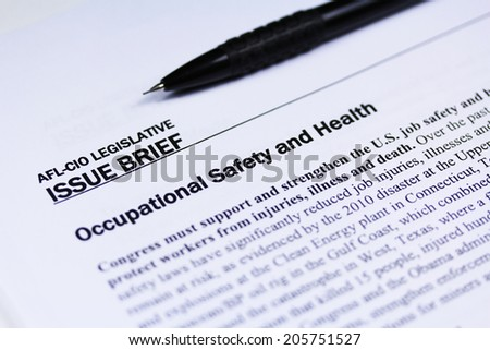 Labor safety text close up with a pen - stock photo