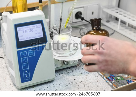 Laborant makes test in research laboratory with electronic measuring equipment on pharmaceutical industry manufacture or chemical plant - stock photo