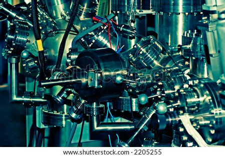 Laboratory abstract - Ultra High Vacuum equipement, Acidic tones - stock photo