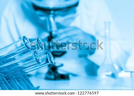 laboratory assistant  a microscope in lab. - stock photo