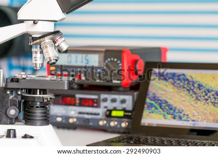 laboratory bench with microscope - stock photo