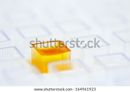Laboratory cuvette with unknown substance - stock photo