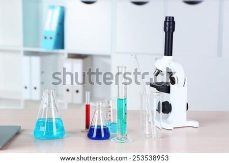 Laboratory equipment on table - stock photo