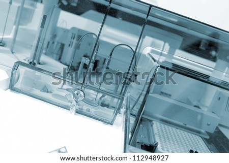 Laboratory facility under protective glass. - stock photo