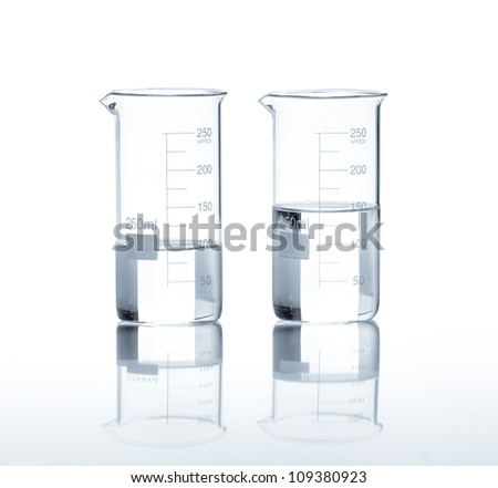 Laboratory flasks with a clear liquid, isolated - stock photo
