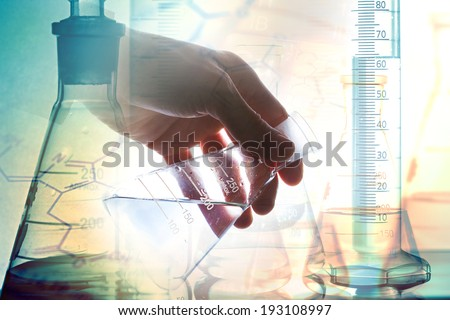 Laboratory glass in arm. Laboratory concept.  - stock photo
