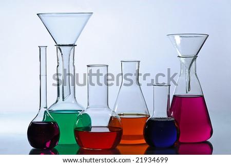 laboratory glassware reflected - stock photo