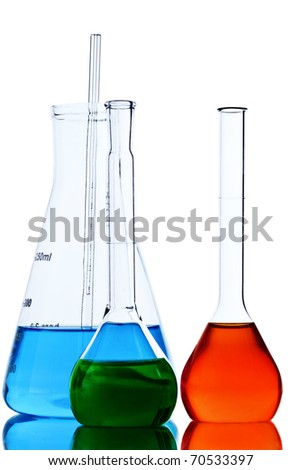 Laboratory glassware test tubes and vial with blue liquid - stock photo