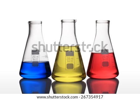 laboratory glassware with blue,yellow and red liquid - stock photo