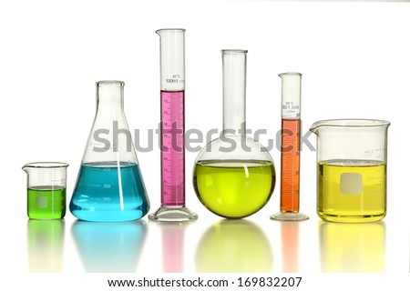 Laboratory glassware with colored liquids over white background - With Clipping Path - stock photo