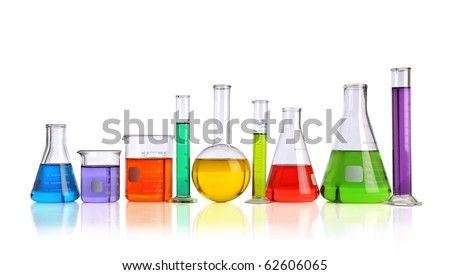 Laboratory glassware with liquids of different colors with reflections on table - With clipping path - stock photo