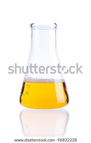 Laboratory glassware with yellow liquids on white background - stock photo