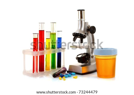 Laboratory metal microscope and test tubes with liquid isolated on white - stock photo