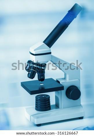 Laboratory microscope lens.modern microscopes in a lab. - stock photo