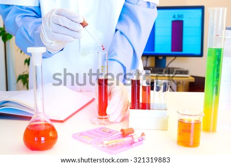Laboratory technician performs testing of chemicals in the laboratory, Laboratory research, photography - stock photo