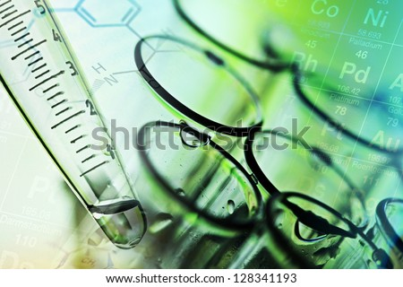 Laboratory tools in green tone. Chemical or medical theme. - stock photo