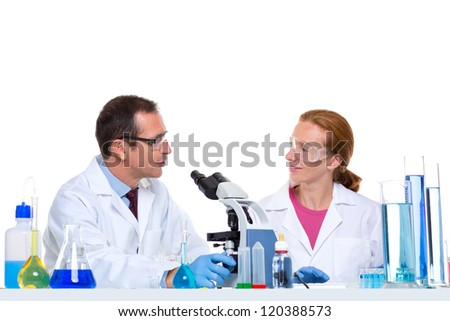 laboratory with two scientist working with test tubes flask and microscope - stock photo