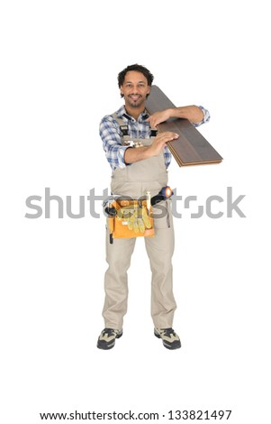 Labourer carrying plywood - stock photo