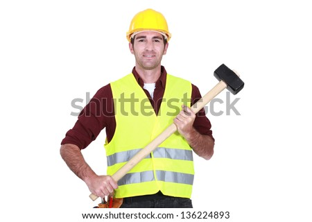 Labourer holding a mallet - stock photo