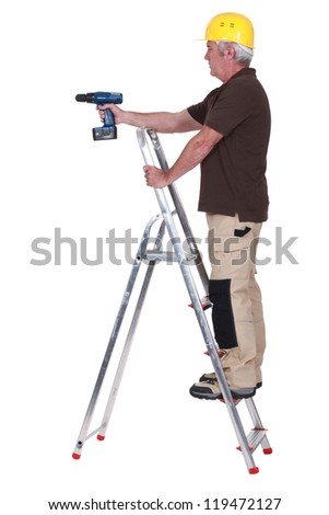 Labourer using a cordless screwdriver - stock photo