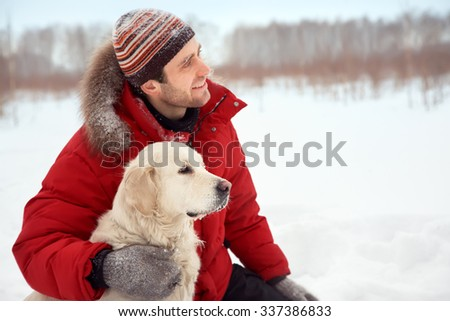 Labrador retriever dog for a walk with its owner in the winter outdoors - stock photo