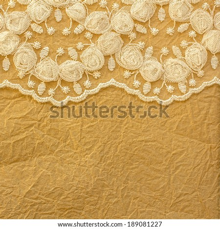 Lace and  crumpled paper background - stock photo