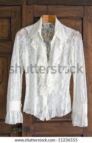 Lace Blouse hanging on antique closet - stock photo