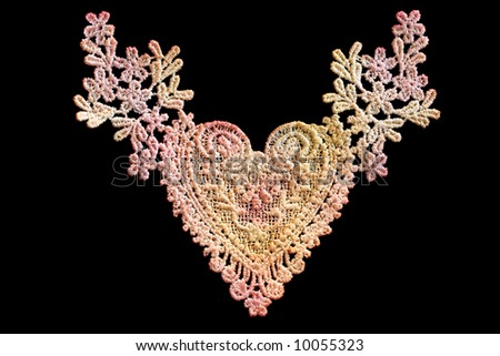 Lace heart in shades of pink and yellow, isolated on black. - stock photo