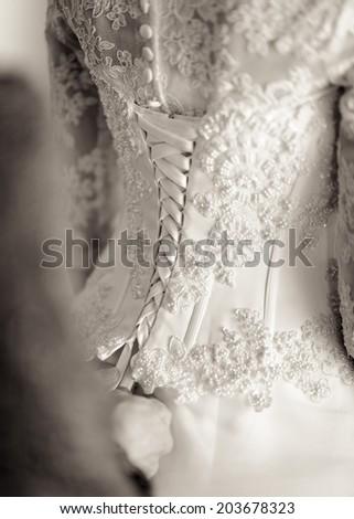 Lacing wedding dress - stock photo