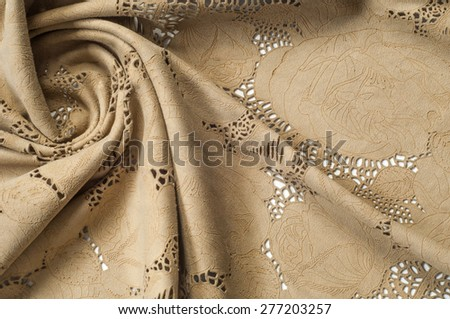 lacy texture of the skin. texture fragment beige lace leather studio - stock photo