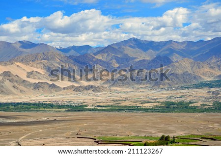 LADAKH, INDIA AUGUST 2, 2014: Ladakh Range is a segment of the Karakoram mountain range, that extends for 370 kilometers. It parallels the northeast bank of the Indus River. - stock photo