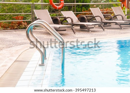 Ladder by The pool of a Common Swiming Pool - stock photo
