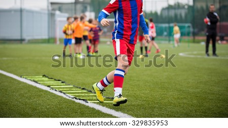 Ladder Drills Exercises for Football Soccer team. Young player exercises on ladder drills - stock photo