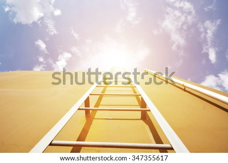 Ladder into sky over the wall - stock photo