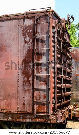 Ladder on an old rusty freight car on a train - stock photo