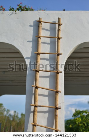 ladder on white wall  - stock photo