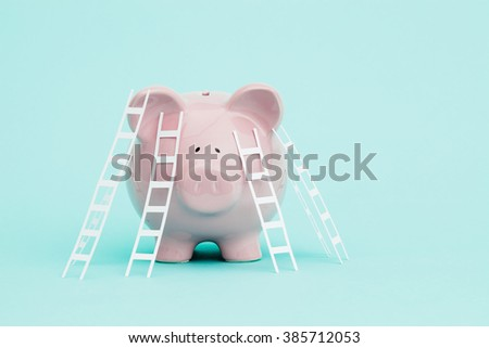 Ladders to climb onto a piggy bank. - stock photo