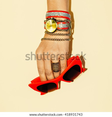 Ladies Accessories. Stylish Bracelets and Sunglasses. Summer Trend - stock photo
