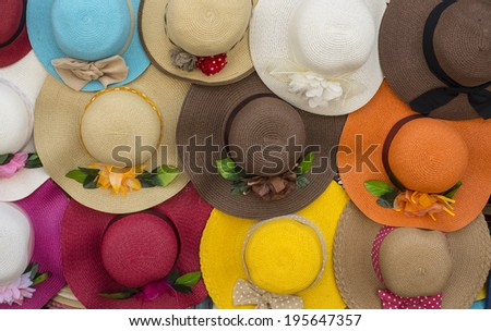 Ladies hats hanging on a wall. - stock photo