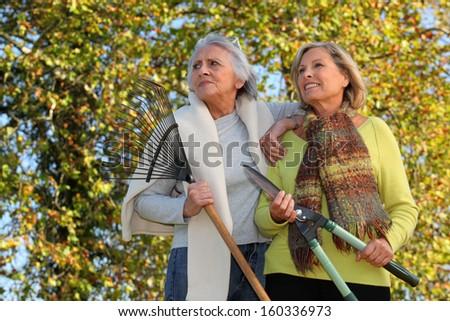 Ladies in the Garden - stock photo