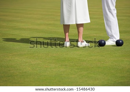 Ladies match at a lawn bowling competition. - stock photo