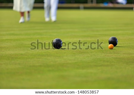Ladies playing lawn bowls - stock photo
