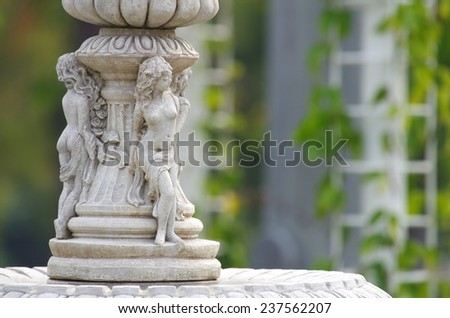ladies sculpture decorated in the garden - stock photo