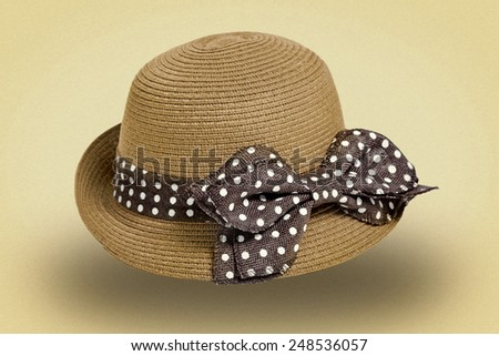 Ladies straw hat with brown ribbon on white background. picture in retro style - stock photo
