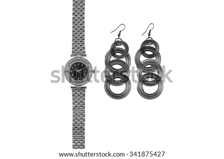 Ladies watch and earrings - stock photo