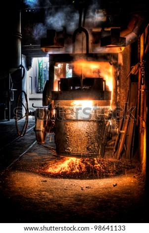 Ladle of molten steel in a iron foundry - stock photo