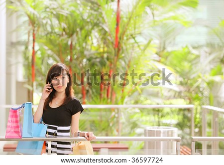 Lady Airport Shopping in Her Travels - stock photo
